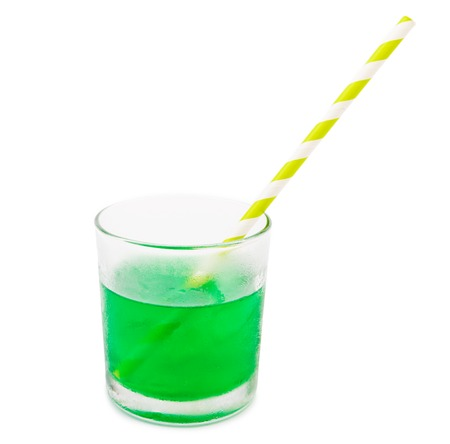 Cocktail glass with bubbles and a straw, isolated on white