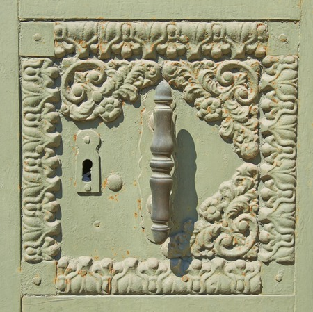 antique keyhole: Door handle and keyhole, antique metal ornament painted tender green