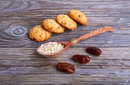 interleaved: Oatmeal cookies tasty breakfast and cereal in spoon on a wooden background Stock Photo