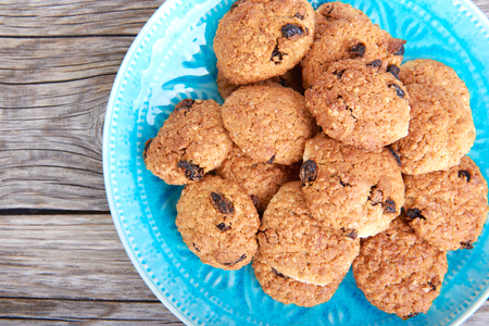 interleaved: Oatmeal cookies tasty breakfast on the plate on a wooden background