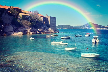 stephen: Sandy beach, sunny days, rainbow landscape and the Adriatic Sea in St. Stephen in Montenegro.