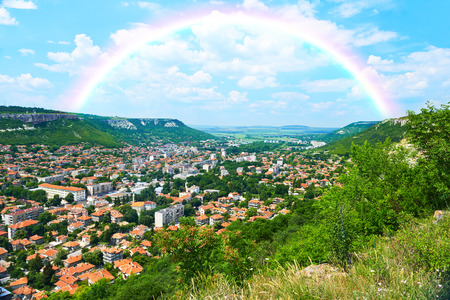 City view with mountains, nature landscape and rainbow in Provadia in Bulgaria Stock Photo