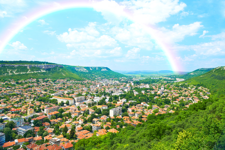 topsail: City view with mountains, nature landscape and rainbow in Provadia in Bulgaria Stock Photo