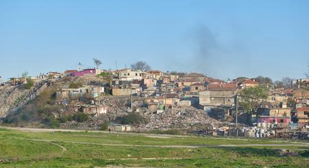 Gypsy slum in Varna, Bulgaria, town city urban settlement, poverty, garbage or junkyard, houses and shacks made of wood or metal