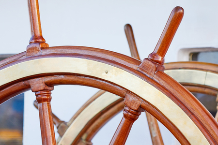 steering wheel of an old sailing ship. Made of wood and copper