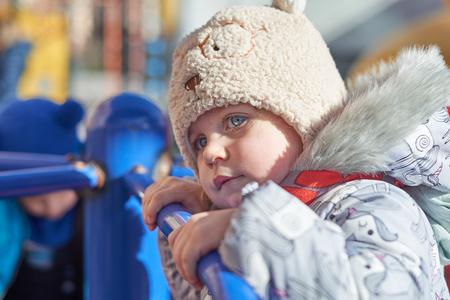 Active little girl on playground - closeup shot
