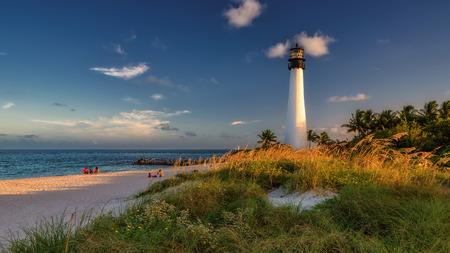 Beach and Lighthouse on sunset, Miami, Florida photo