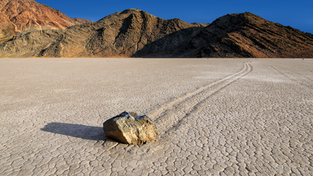 Sailing Rocks at Racetrack Playa Death Vally National Park. Sailing Rocks leave trails on the Racetrack.