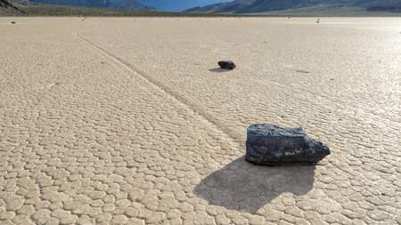 Moving stone in the desert of Death Valley California photo
