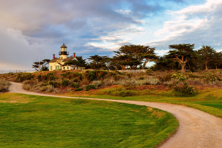lighthouse with beam: View of Point Pinos lighthouse on the Monterey coast. Stock Photo