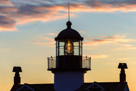 lighthouse with beam: Lighthouse at sunset on the Monterey coast.