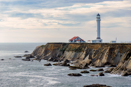 lighthouse with beam: Point Arena Lighthouse at sunset, Pacific Ocean