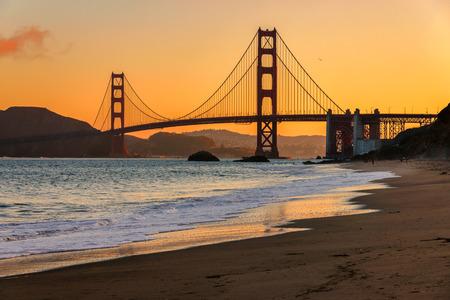 san: Sunrise at the beach near the Golden Gate Bridge Stock Photo