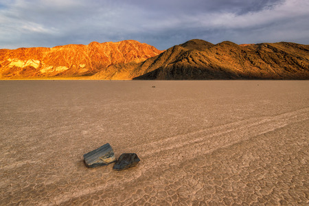 inscribe: Sunset at The Racetrack, is a scenic dry lake with sailing stones that inscribe linear racetrack imprints