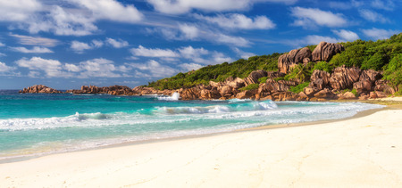 Paradise shaped granite boulders and a perfect white sand at Grand Anse beach, La Digue island, Seychelles
