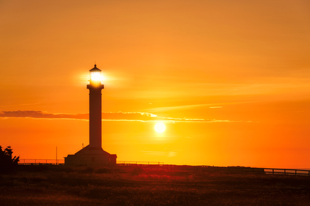 lighthouse with beam: Lighthouse beam at sunset in North California