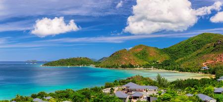 blue lagoon: Paradise beach on tropical island Praslin at sunset in Seychelles
