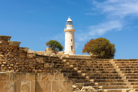 Ancient amphitheatre and old lighthouse in Paphos, Cyprus. Archaeological site of Kato Paphos. Stock Photo