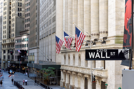Wall Street sign and New York Stock Exchange Editorial