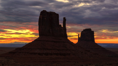 Monument Valley silhouettes at sunrise, Utah Stock Photo