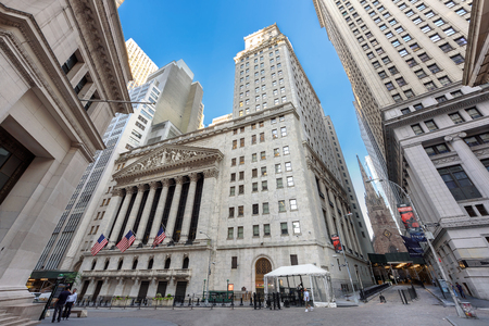 Famous Wall street and New York Stock Exchange at morning, New York, USA