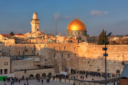 Sunset at Western Wall and golden Dome of the Rock, Jerusalem, Israel.