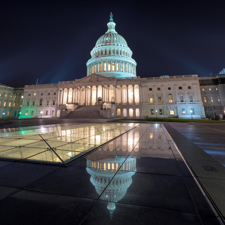 Washington DC, US Capitol Building at night with mirror reflection, USA.