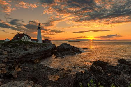 Sunrise at Portland Head Lighthouse on the Atlantic Ocean in Cape Elizabeth, Maine.