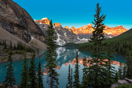The Moraine lake at Sunrise in Rocky Mountains, Banff National Park of Canada.