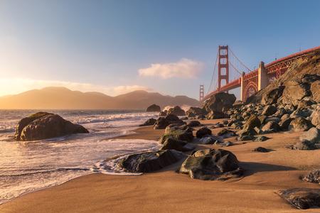 Golden Gate Bridge at sunset seen from San Francisco beach. Stock Photo