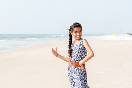 Portrait of young slim beautiful girl on sunset beach Stock Photo