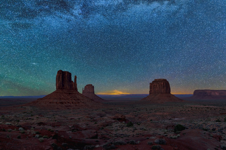 Beautiful night sky whit stars over Monument Valley at sunrise in Arizona