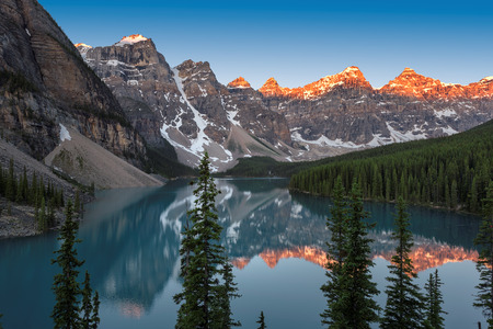 Sunrise under turquoise waters of the Moraine lake in Rocky Mountains, Banff National Park, Canada. Фото со стока