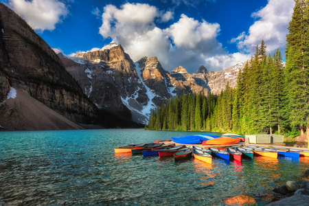 Colorful canoe in Moraine Lake in Rocky Mountains, Banff National Park, Canada.