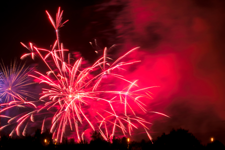 New Year event red color fireworks. New year and holidays concept. Фото со стока