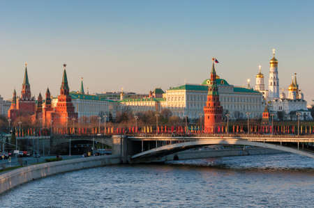 Moscow skyline at sunset with Kremlin and Kremlin Wall, and City towers. Moscow Russia.