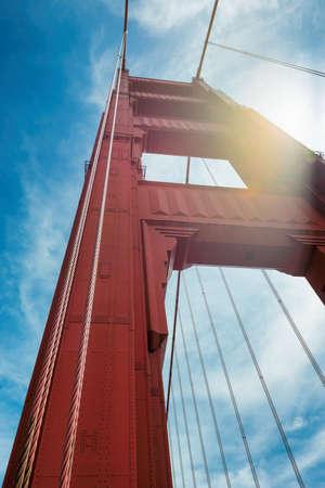 Golden Gate Bridge, perspective of tower of bridge support sunset in San Francisco, California.