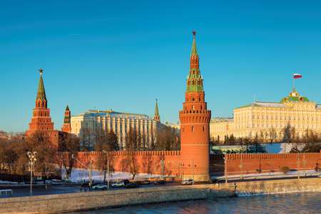 Moscow Kremlin in winter with ice river. Kremlin Wall, towers and Grand Kremlin Palace. Moscow Russia.