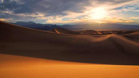 Desert sand dunes at sunrise in California, USA 免版税图像