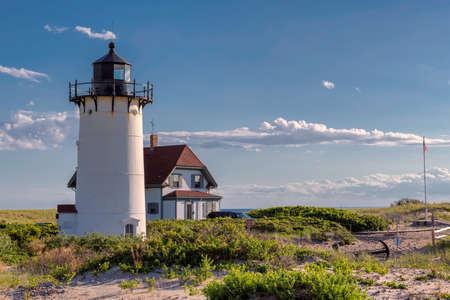 Race Point Light Lighthouse in sand dunes on the beach at Cape Cod, New England, Massachusetts, USA. 免版税图像 - 152428684
