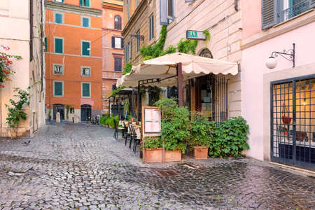 Old cozy street in Rome at morning, Rome, Italy. Architecture and landmark of Rome.
