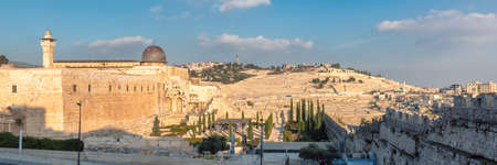 Panoramic view of Temple Mount at sunset in the Jerusalem old city, with the Western Wall and golden Dome of the Rock, Jerusalem, Israel.