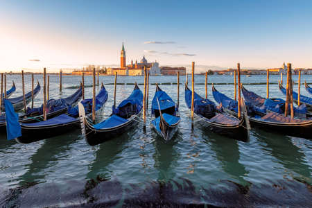 Venice gondolas at sunrise in Grand Canal by San Marco square in Venice, Italy.
