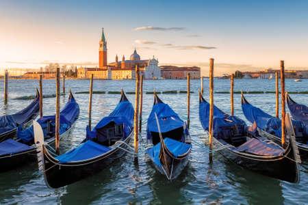 Venice gondolas at sunrise in Grand Canal by San Marco square in Venice, Italy. Zdjęcie Seryjne