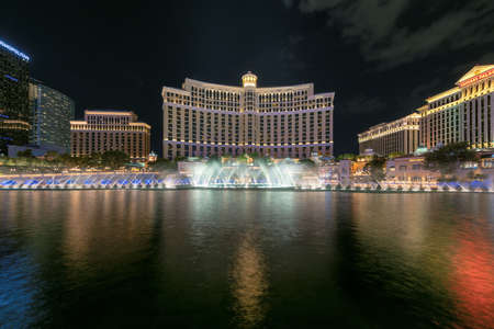 Bellagio hotel and casino at night in Las Vegas Strip in Las Vegas, USA. The Strip is home to the largest hotels and casinos in the world.