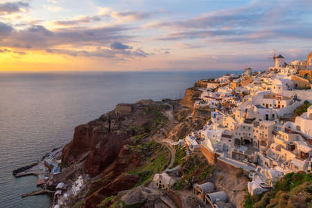Beautiful sunset at Oia village, Santorini island, Greece.