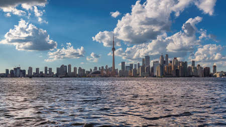Panoramic view of Toronto city with CN Tower at sunny summer day in Toronto, Ontario, Canada.