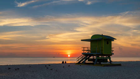 Miami Beach at sunrise and life guard tower, South Miami Beach, Florida.