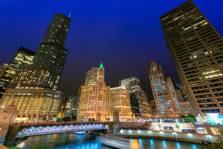 Chicago Downtown and river with Du Sable bridge at night, Chicago, Illinois, USA.