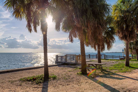 Picnic area and pier on the beach at sunset in Key Biscayne